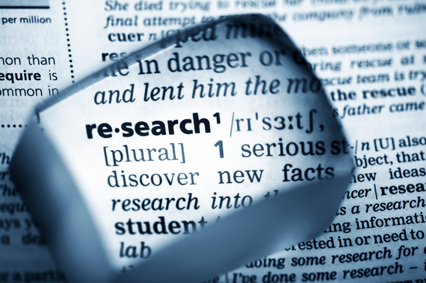 "magnifying glass over the word ""research"